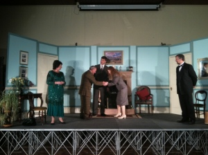 Actors on stage for the play Rebecca